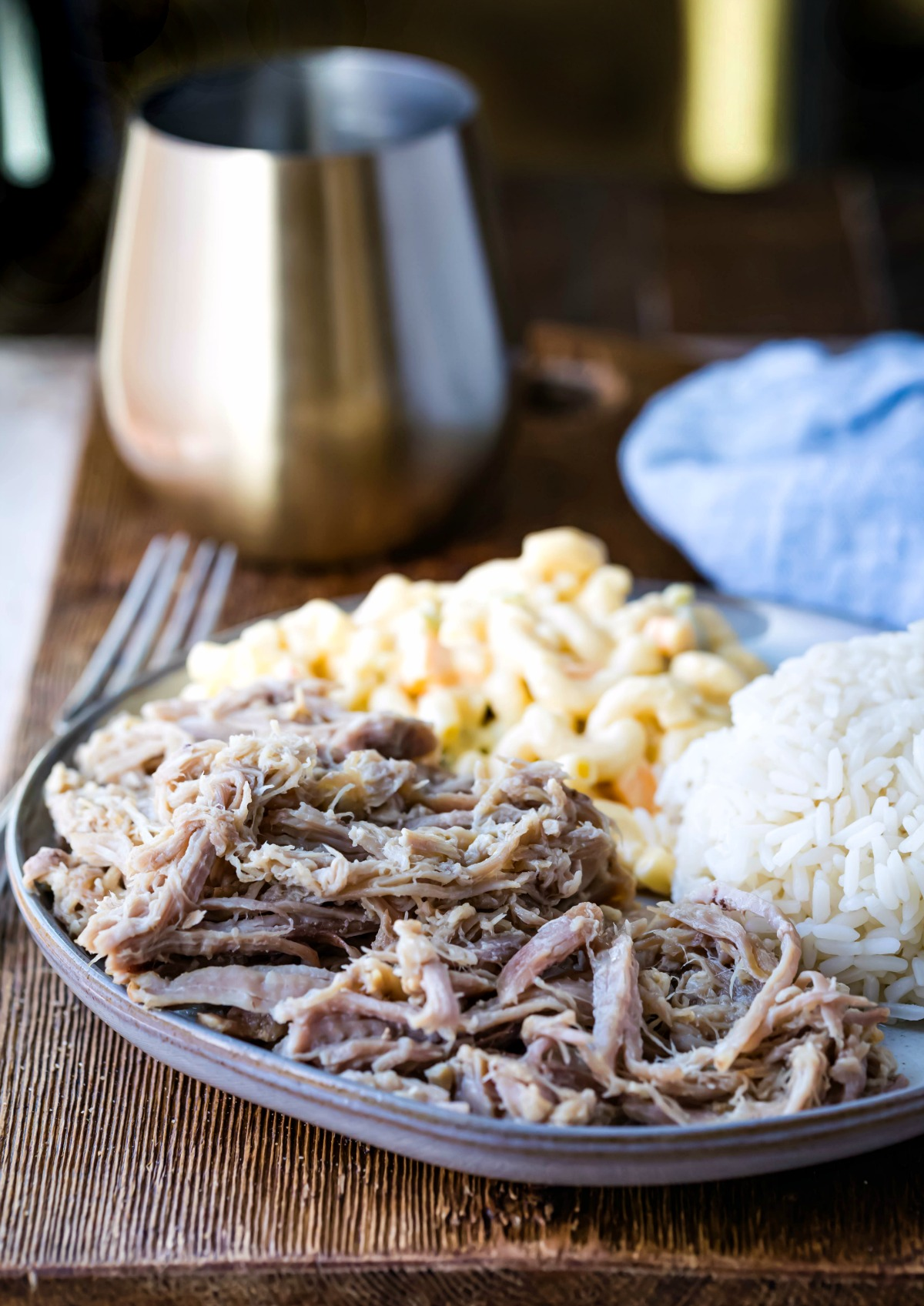instant Pot Kalua Pork on a blue stoneware plate