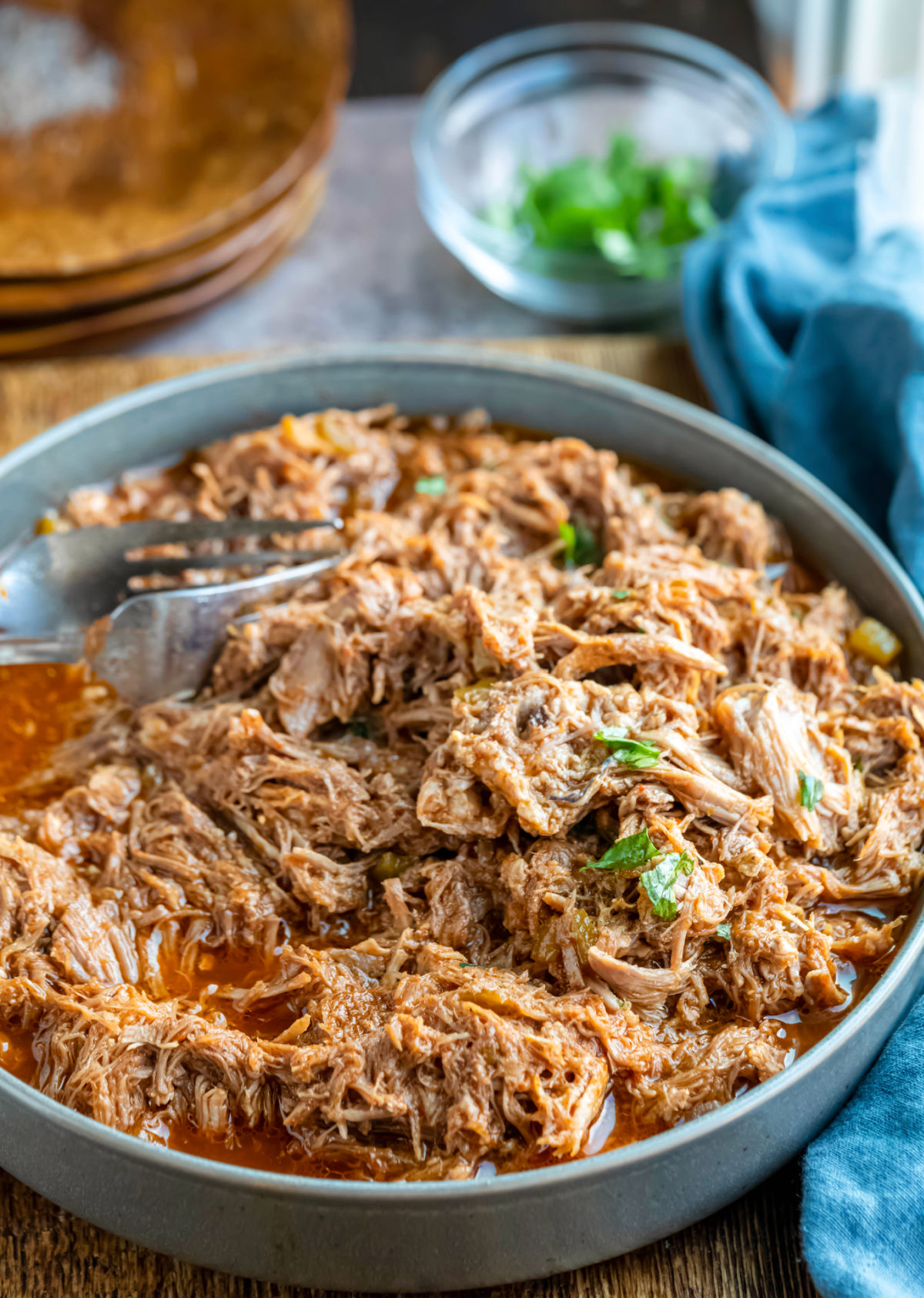 Two forks in a bowl of Instant Pot cafe rio sweet pork