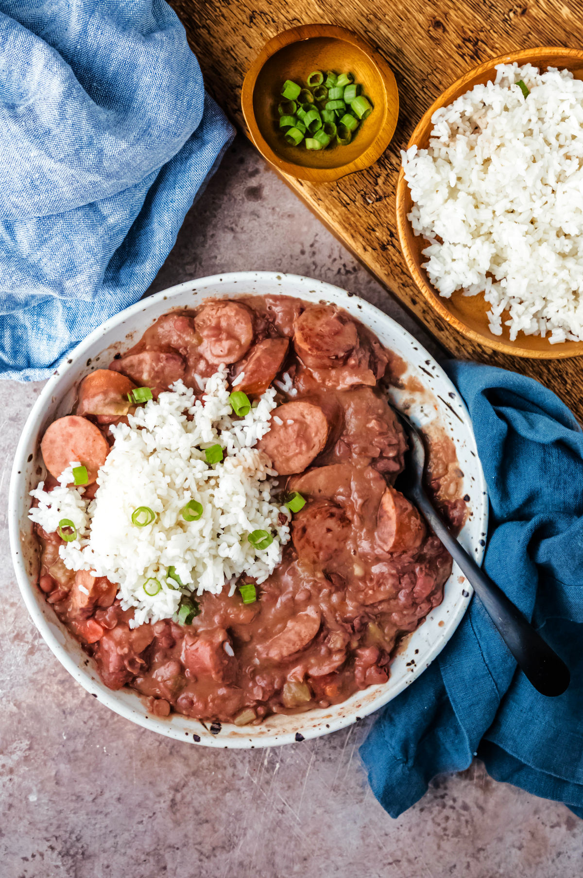 Plate of red beans and rice next to a bowl of white rice