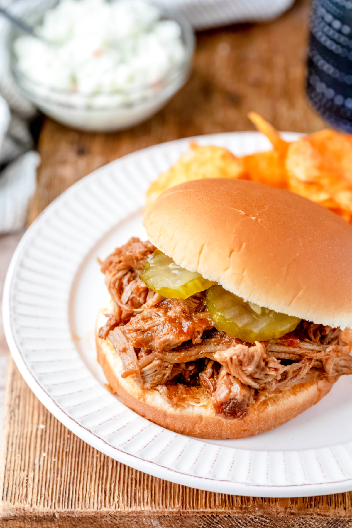 North Carolina pulled pork sandwich next to chips