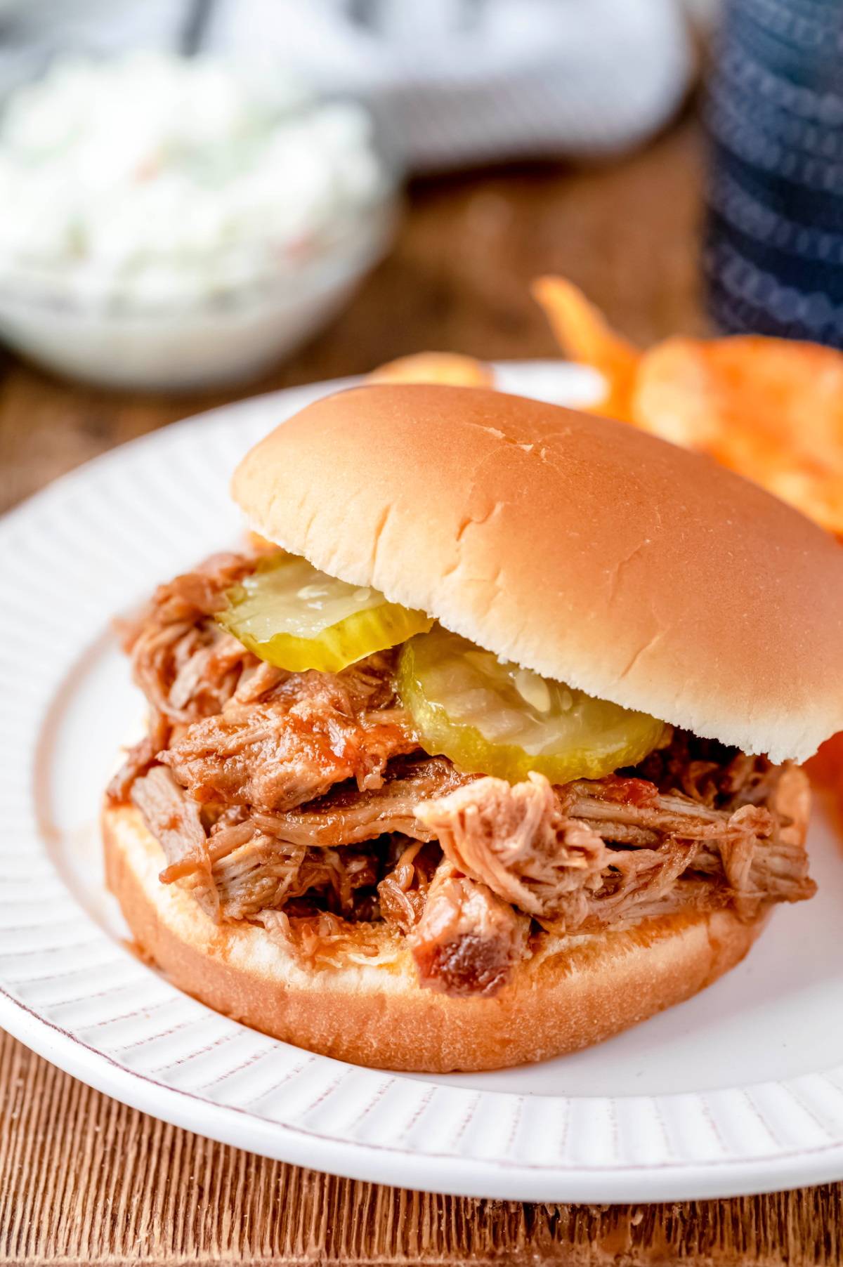 North Carolina pulled pork sandwich topped with pickles