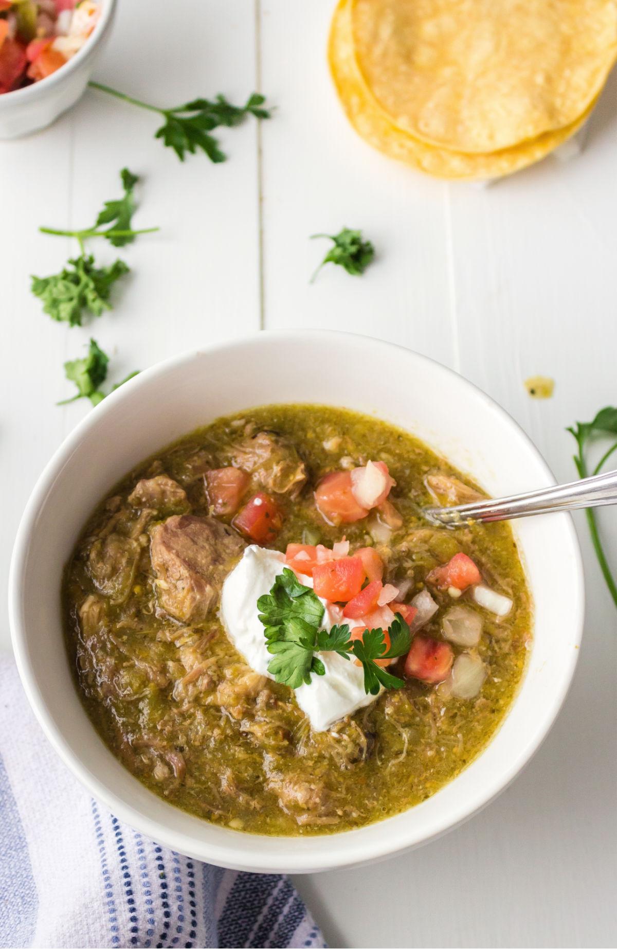 Pork chile verde topped with pico de gallo and sour cream