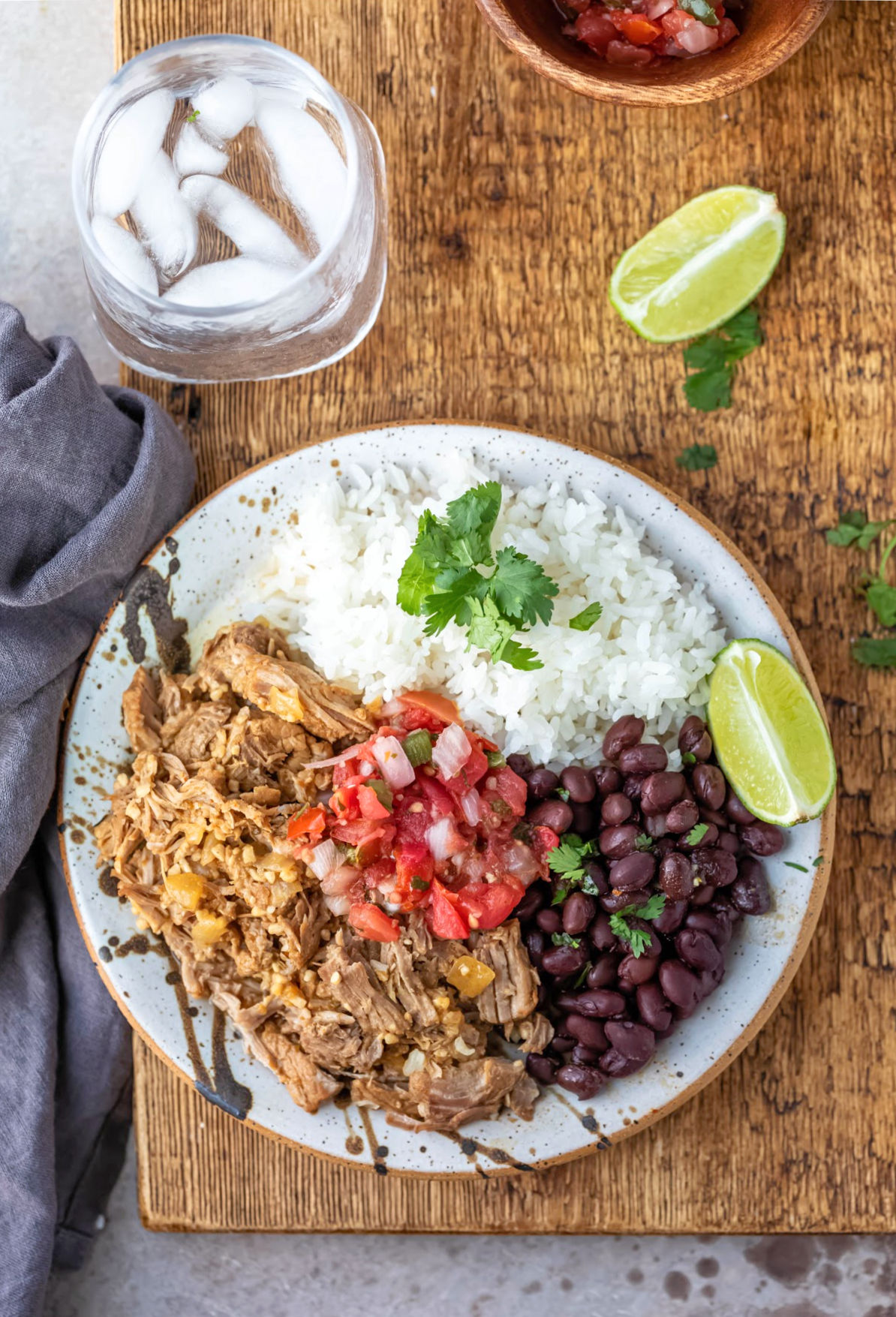 plate of mojo pork with rice and beans.